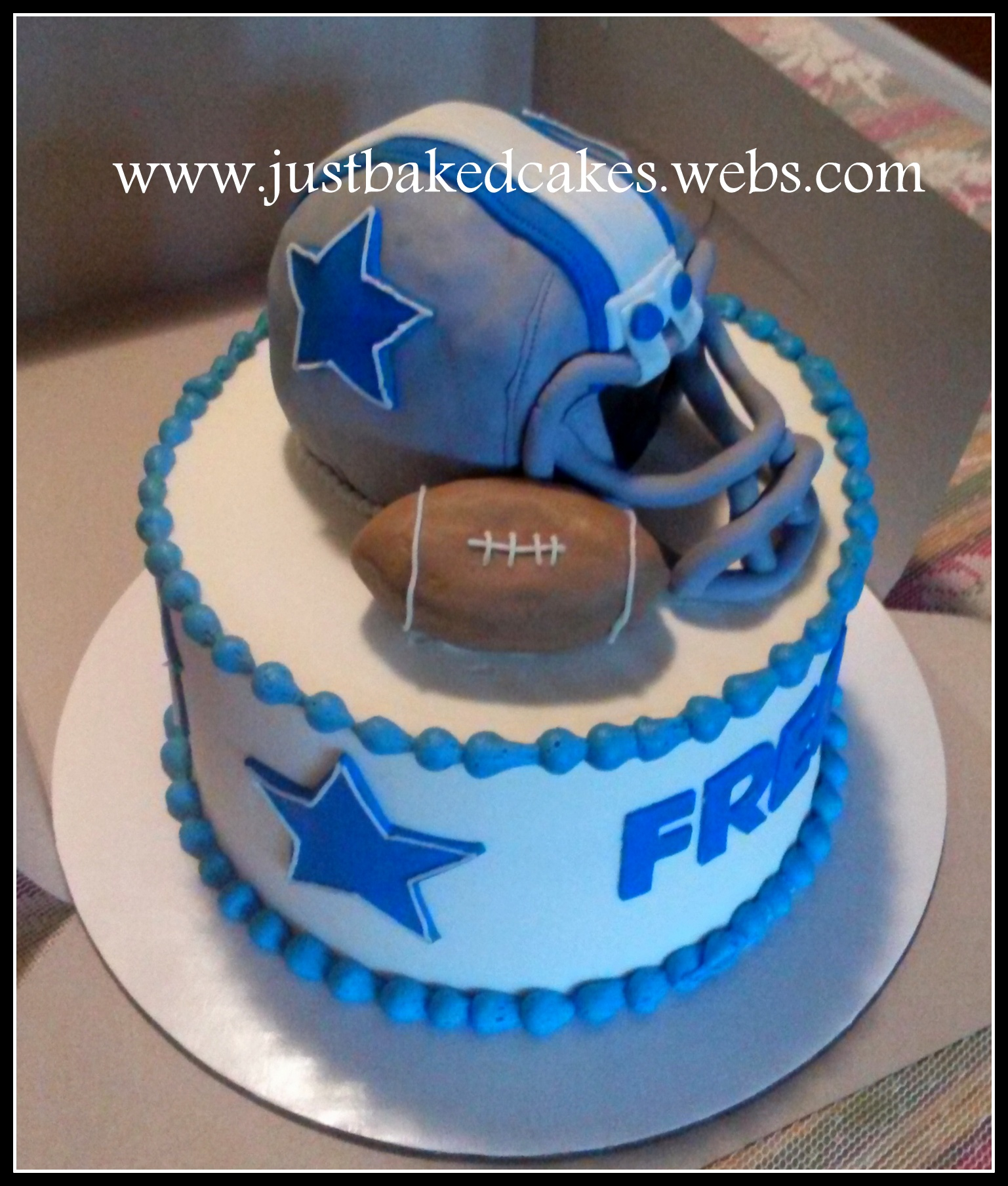 Dallas Cowboys helmet shaped cake